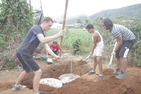 Volunteers install septic tanks for newly built toilet blocks